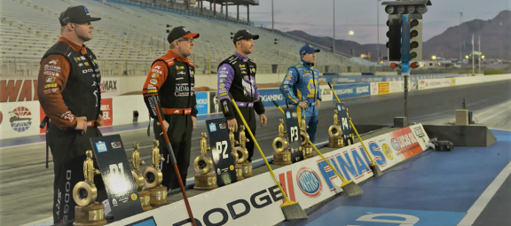 4 DSR drivers holding trophies