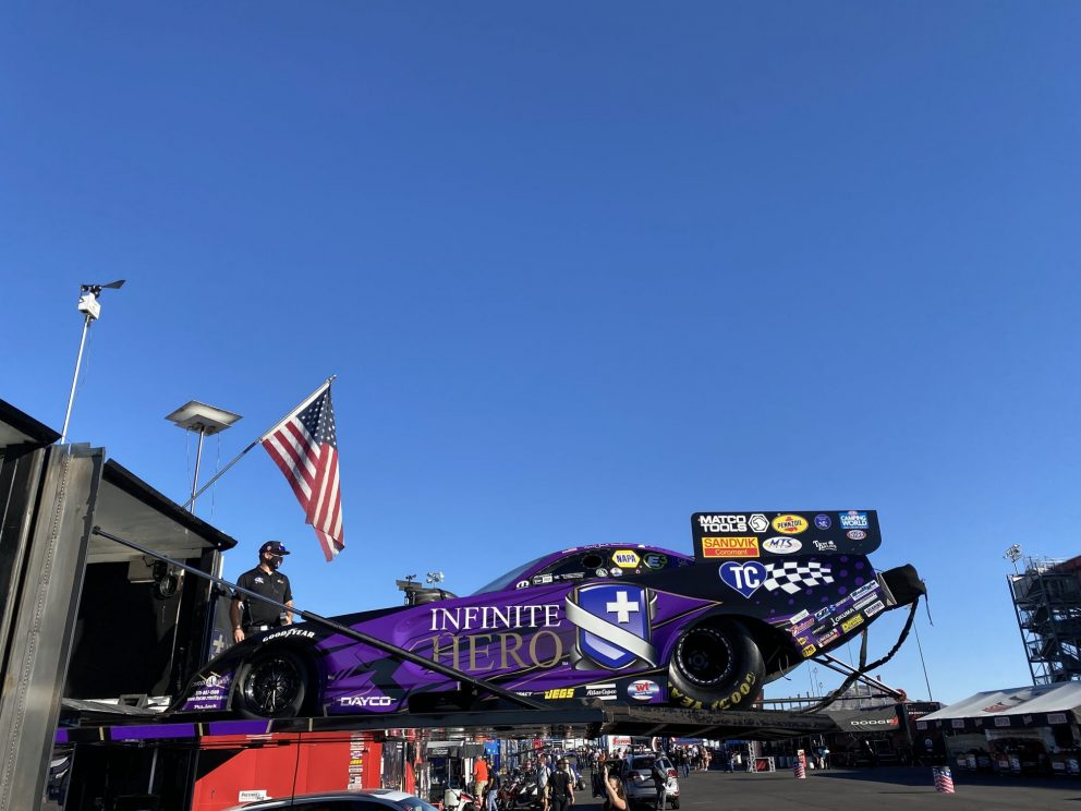 Jack Beckman's funny car being unloaded from the trailer