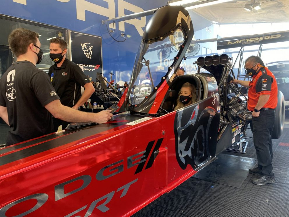 Leah Pruett sitting in her top fuel dragster