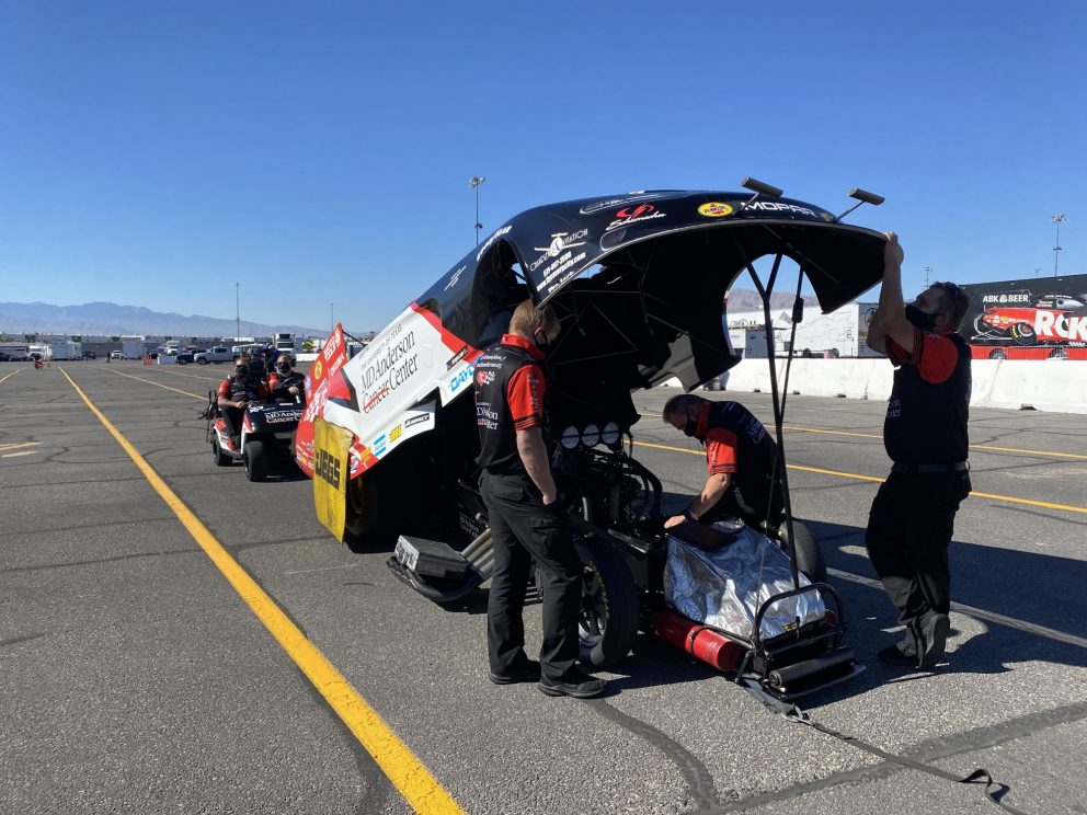 Tommy Johnson Jr.'s crew working on his funny car