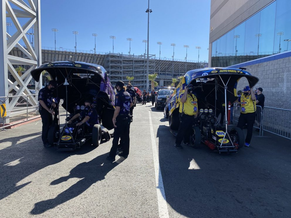 Jack Beckman and Ron Capps' teams working on their funny cars