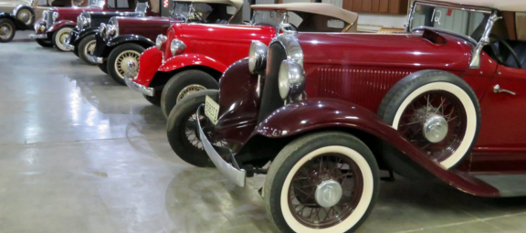 Room full of classic vehicles