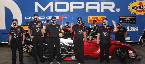 Matt Hagan and crew with a funny car