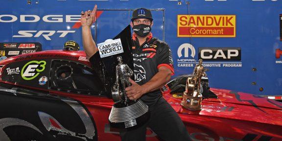 Matt Hagan holding his trophy