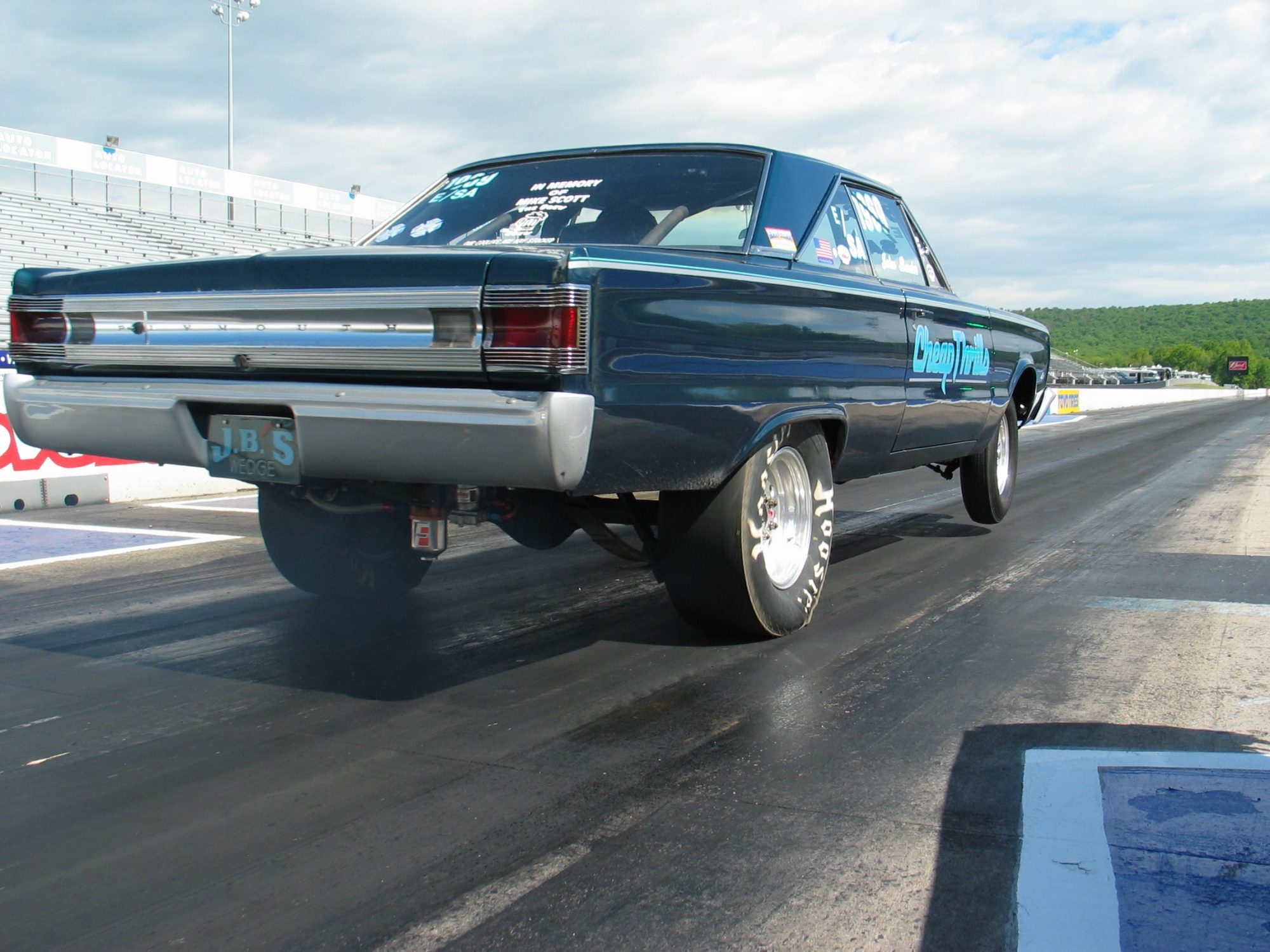 1967 Plymouth Satellite launching off the start line