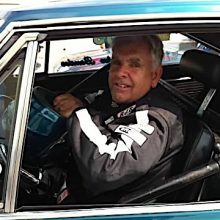 John Bender sitting in the driver seat of his 1967 Plymouth Satellite
