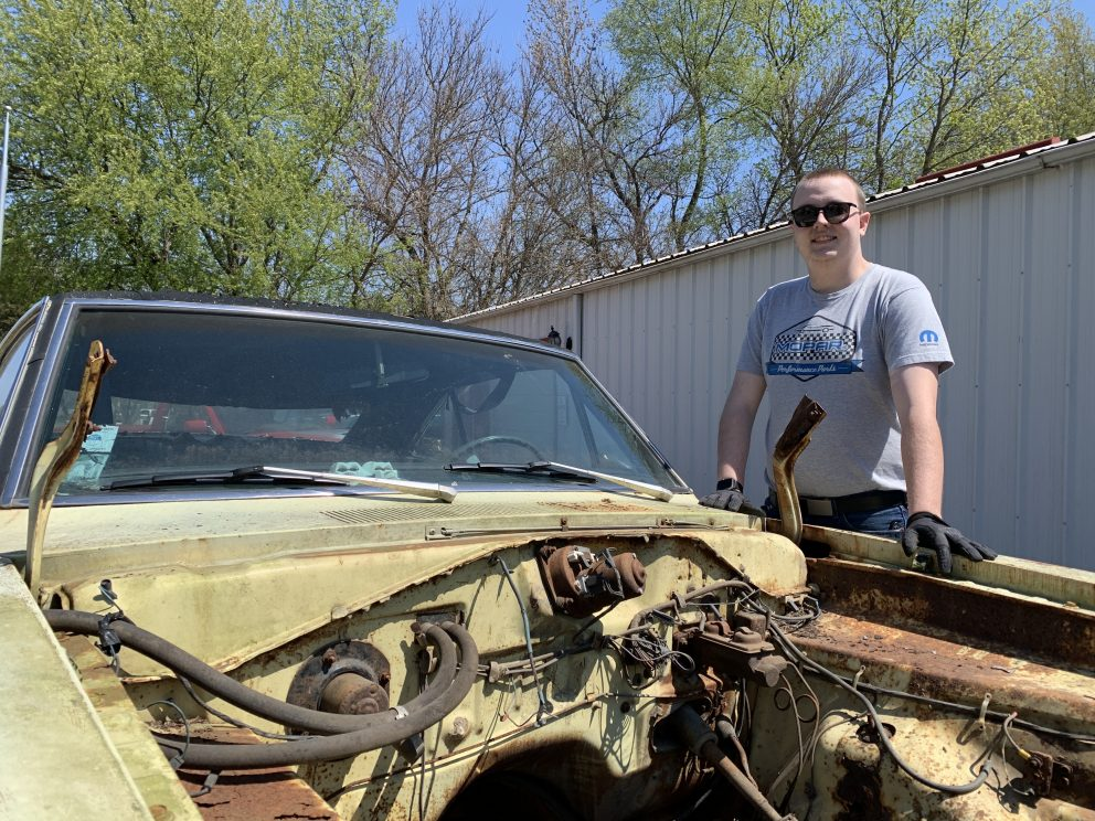 Millenial Mopar Owner -Vehicle without engine. Open hood.