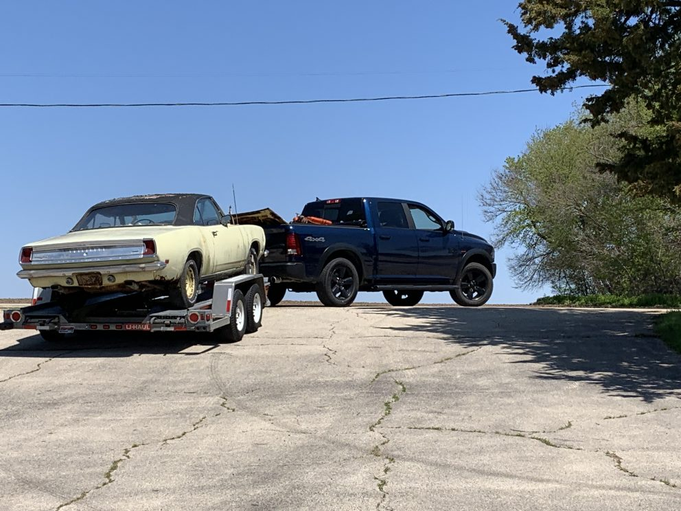 Millenial Mopar Owner -Vehicle on trailer being towed up a hill.