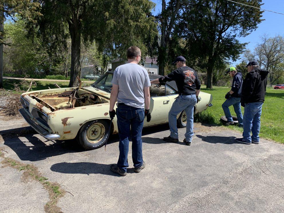 Millenial Mopar Owner - Men inspecting vehicle