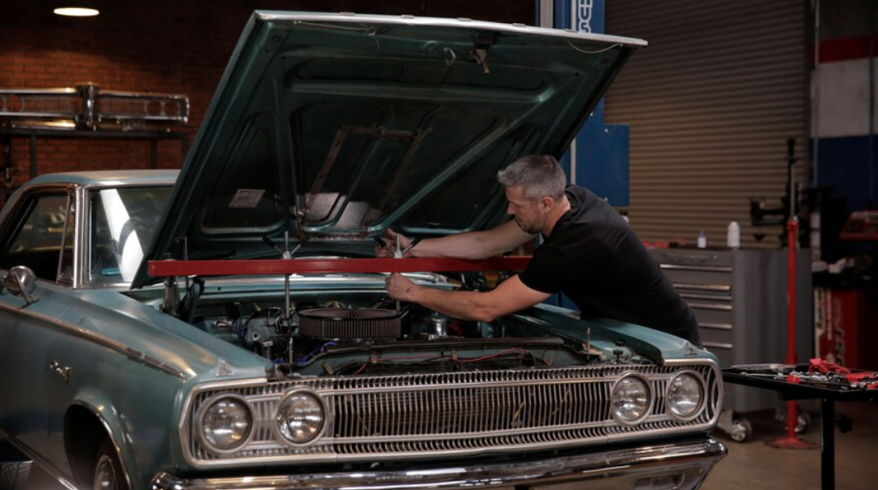 man working on his 1965 Dodge Coronet