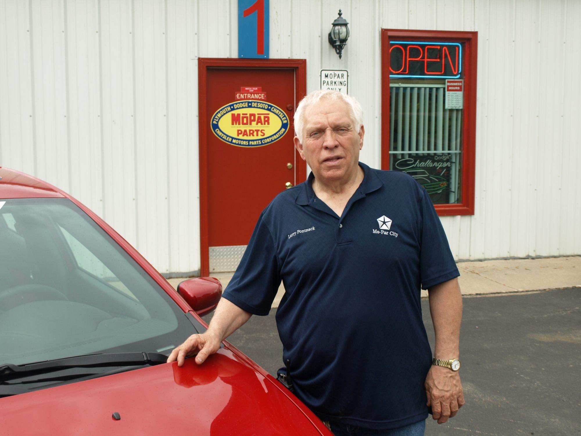 Larry Pontnack standing outside of his Mopar business
