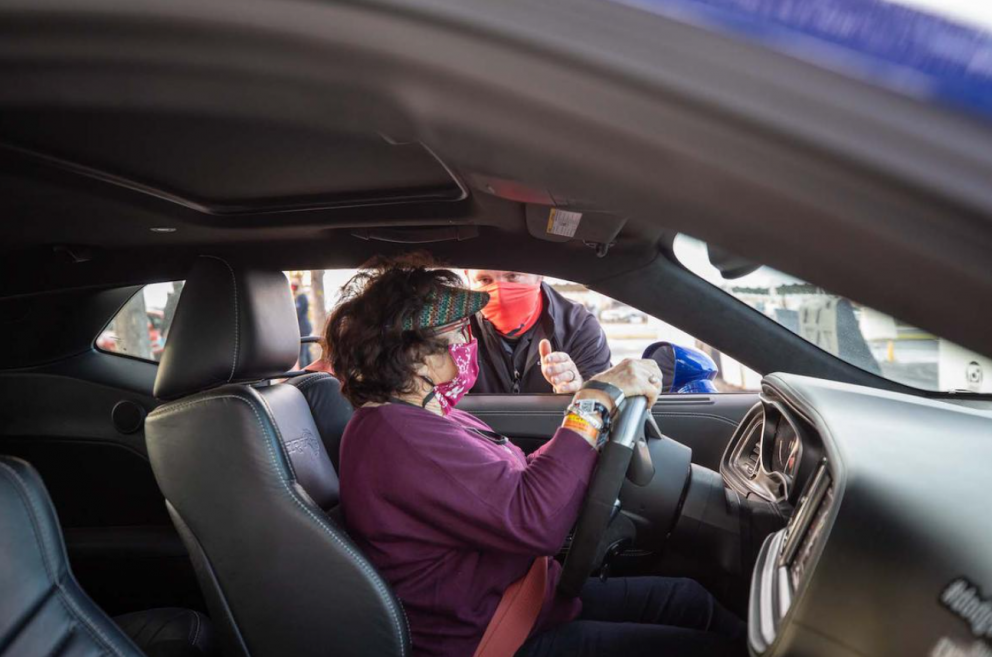 Woman receiving driving instruction in the driver's seat