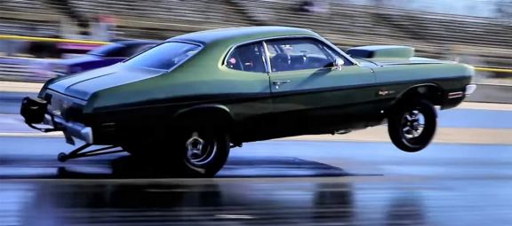 1971 Dodge Demon 340 on two wheels on a drag strip
