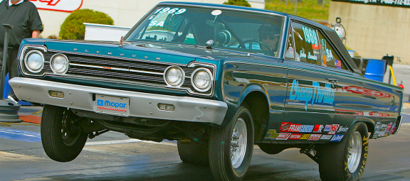 1967 Plymouth Satellite launching off the start line in a drag race
