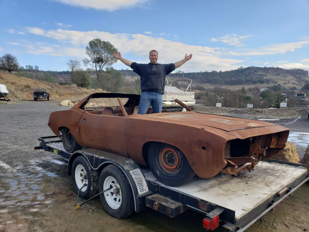 Man with a 1974 Plymouth Barracuda