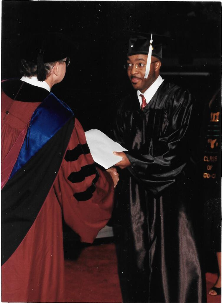 Anthony Carter receiving his degree
