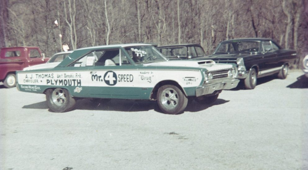 Herb's race car in a parking lot