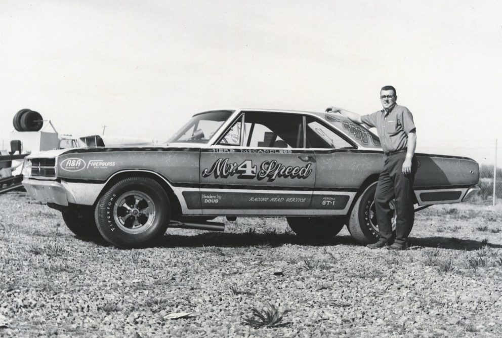 Herb standing next to his race car