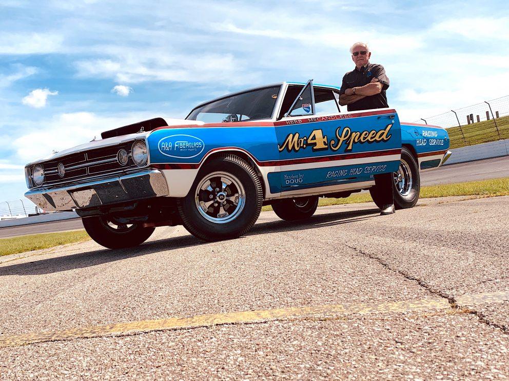 Herb posing next to his race car