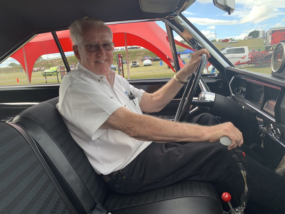 Herb sitting in the driver seat of his race car