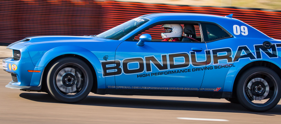 Carolyn driving at Bondurant