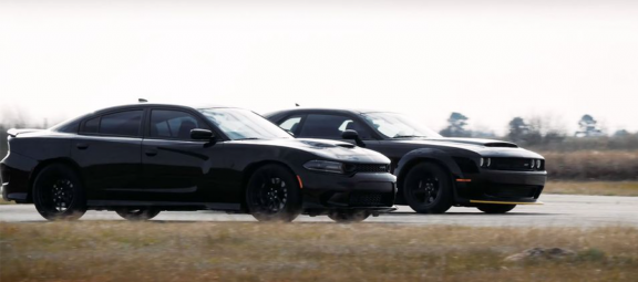 Dodge Charger and Dodge Demon staging for a race