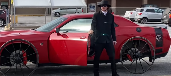 Man standing with a SRT Hellcat on buggy wheels