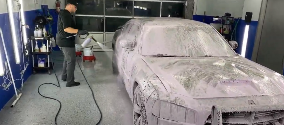 guy washing a car