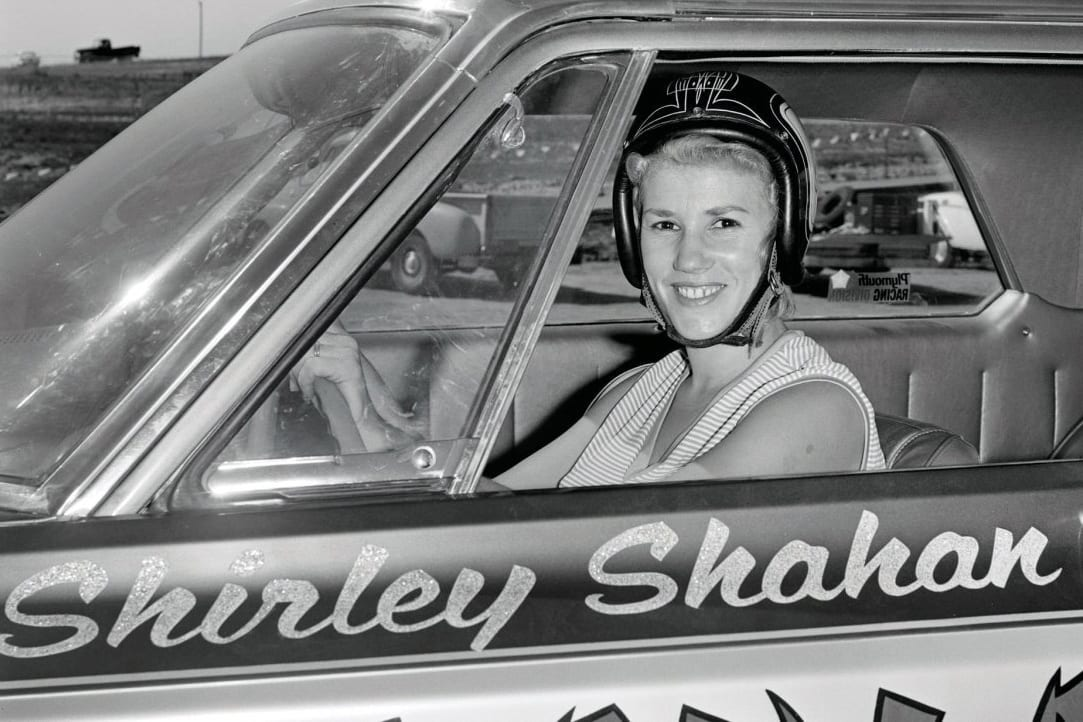 Shirley Shahan sitting in her drag car