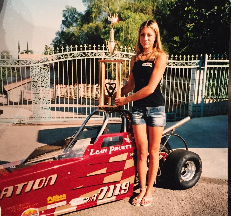 Leah Pruett posing with a trophy