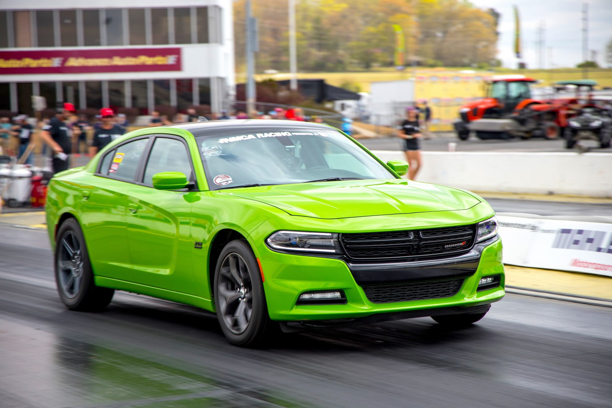 Green Dodge Charger drag racing at NMCA race