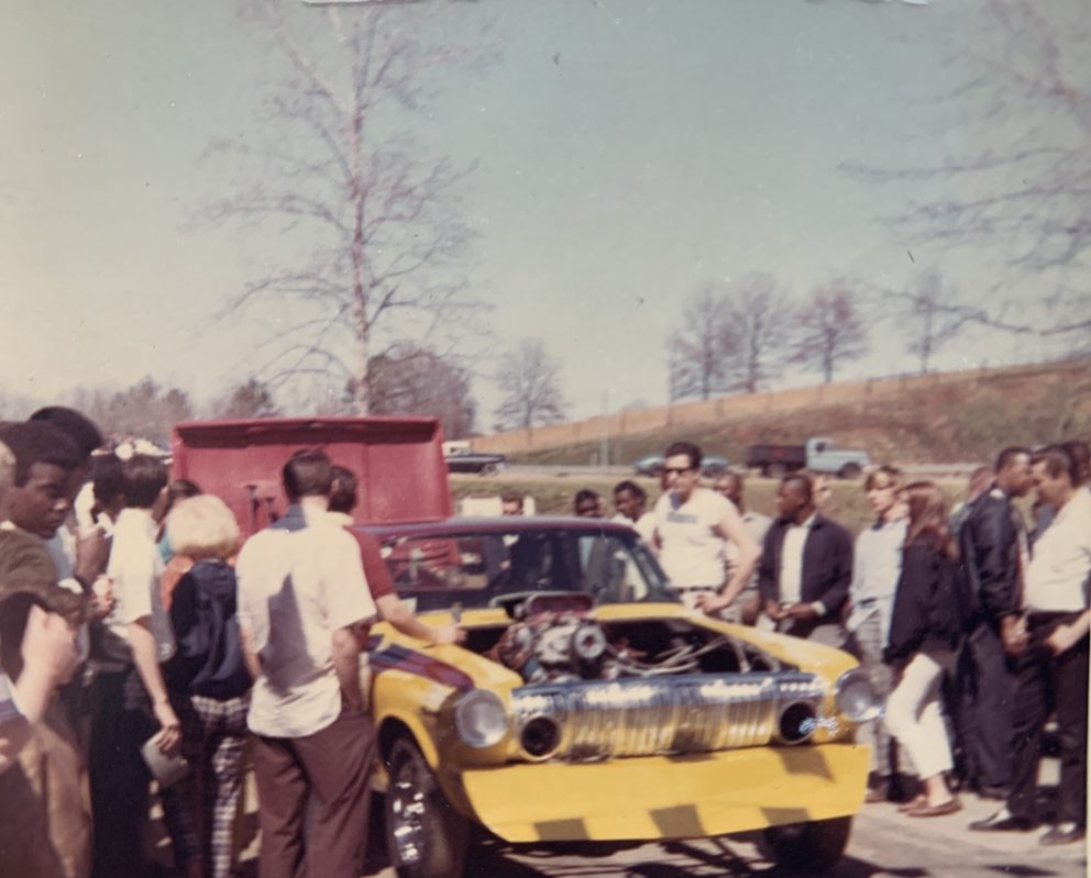 Fans gathering around Della Woods race car