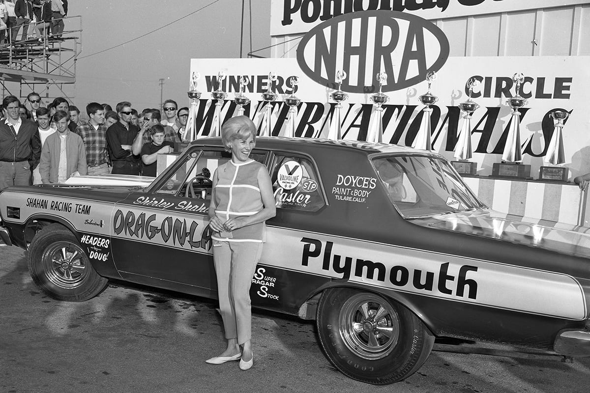 Shirley Shahan standing in front of her drag car