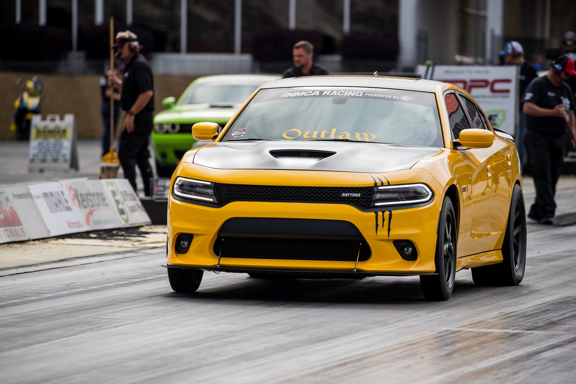 Yellow Dodge Charger drag racing at NMCA event