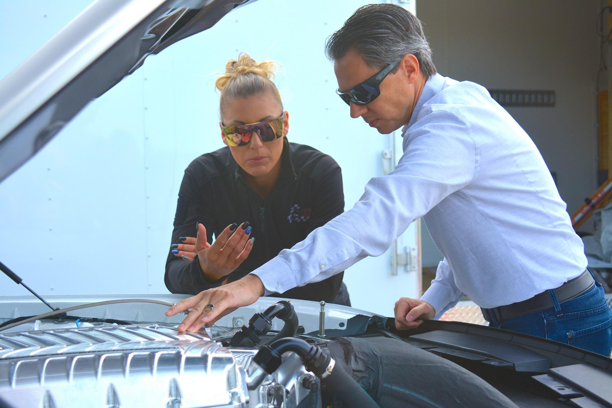 Leah Pruett working on her car