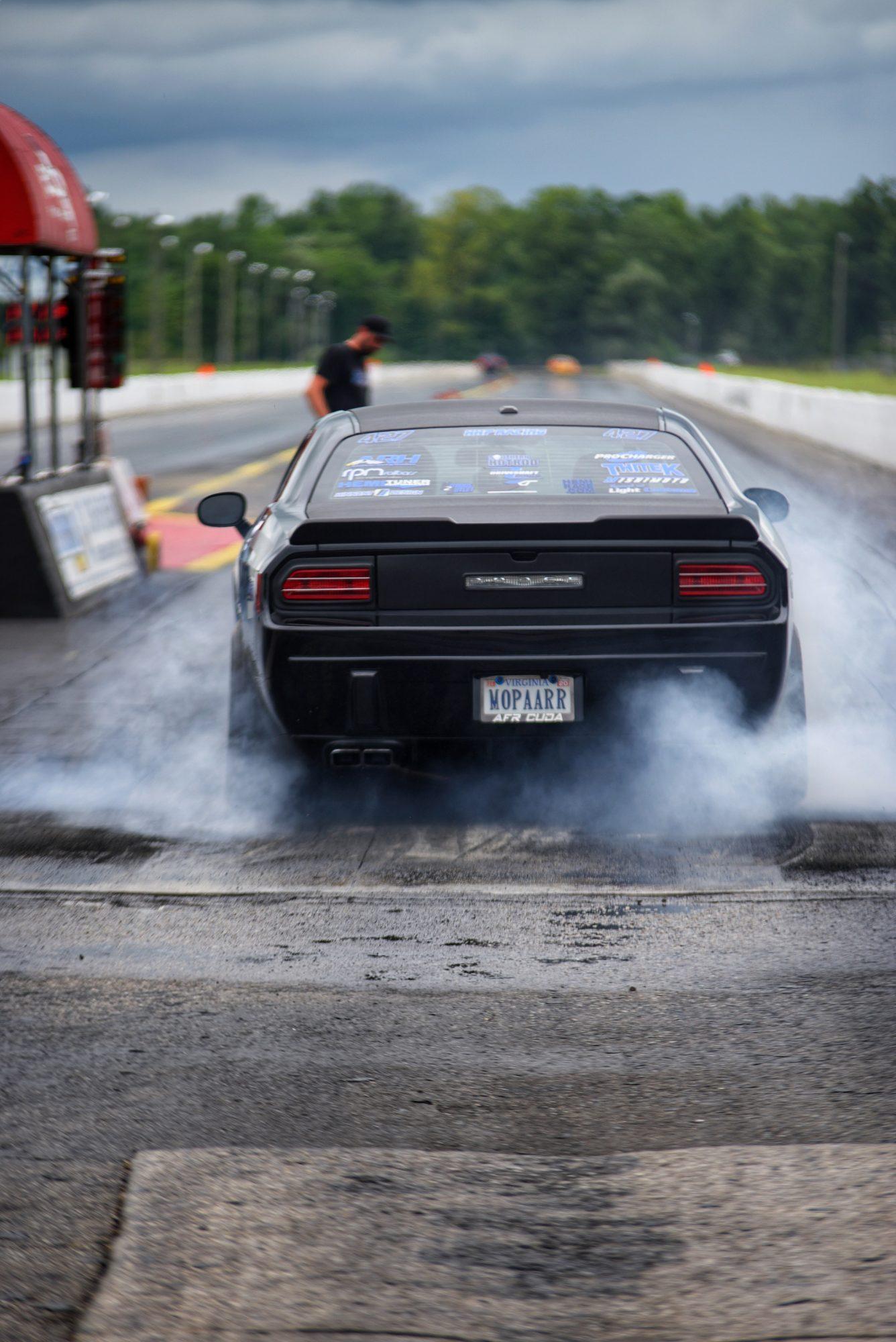 Neichaun doing a burnout before a drag race