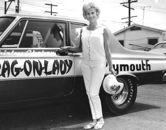 Shirley Shahan posing next to her drag car