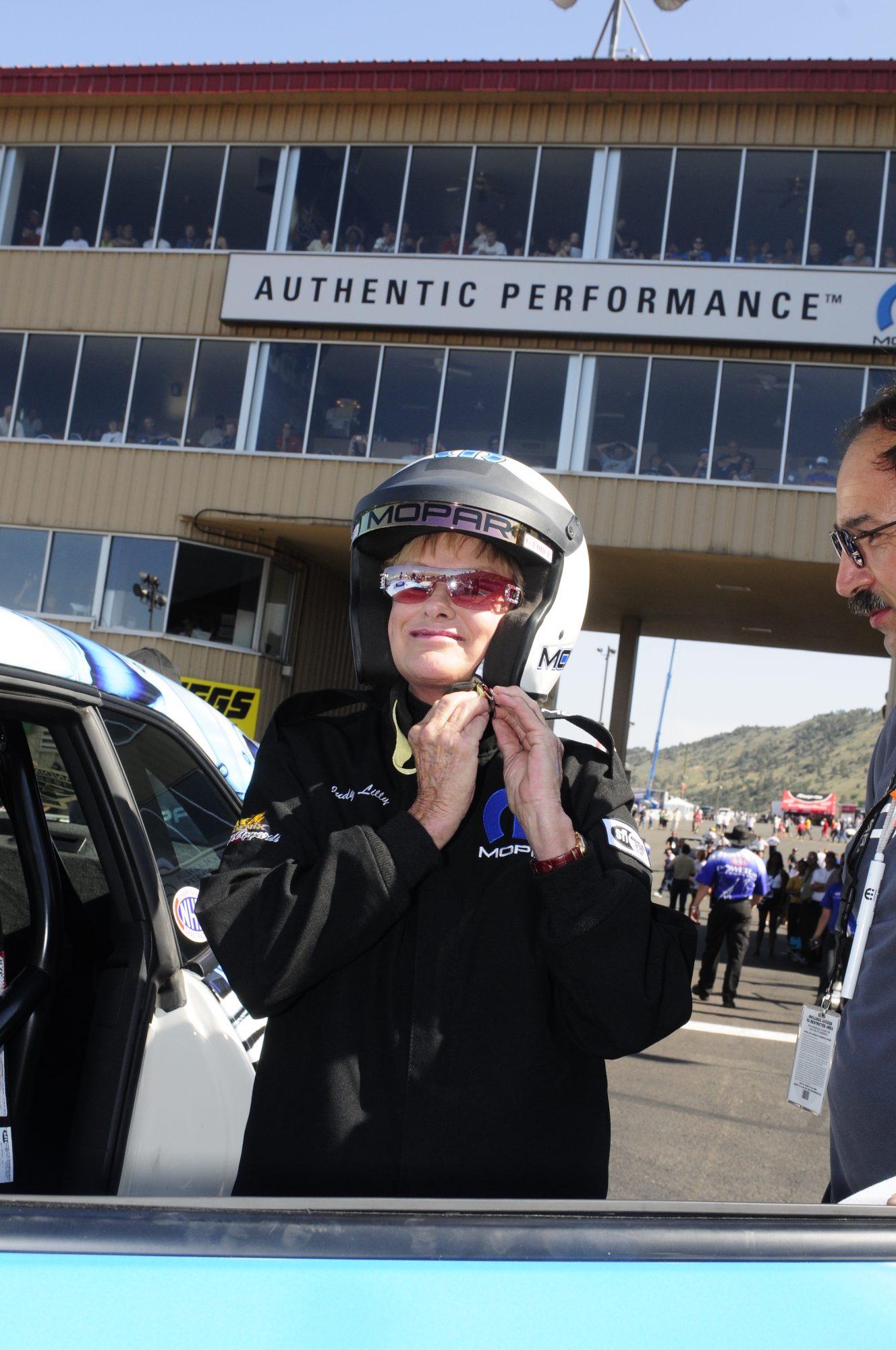 Judy Lilly strapping on a Mopar helmet