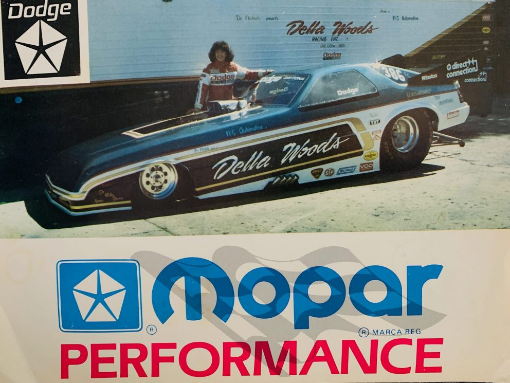 Della Woods standing next to her Funny Car