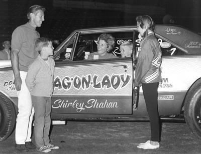 Shirley sitting in her drag car