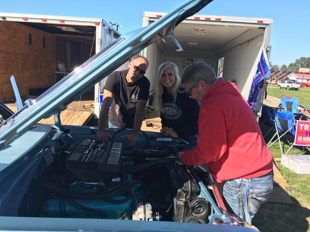 Adrianna Straub working on her car
