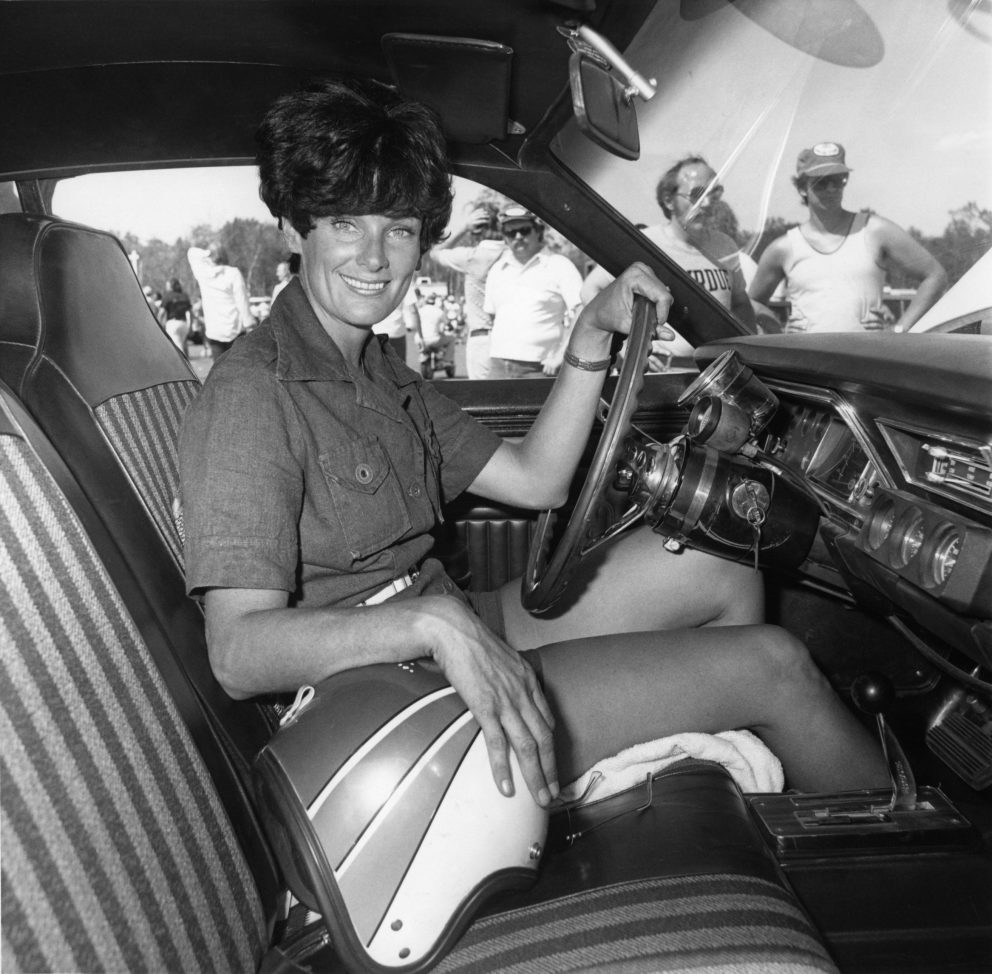 Judy Lilly sitting in her drag car