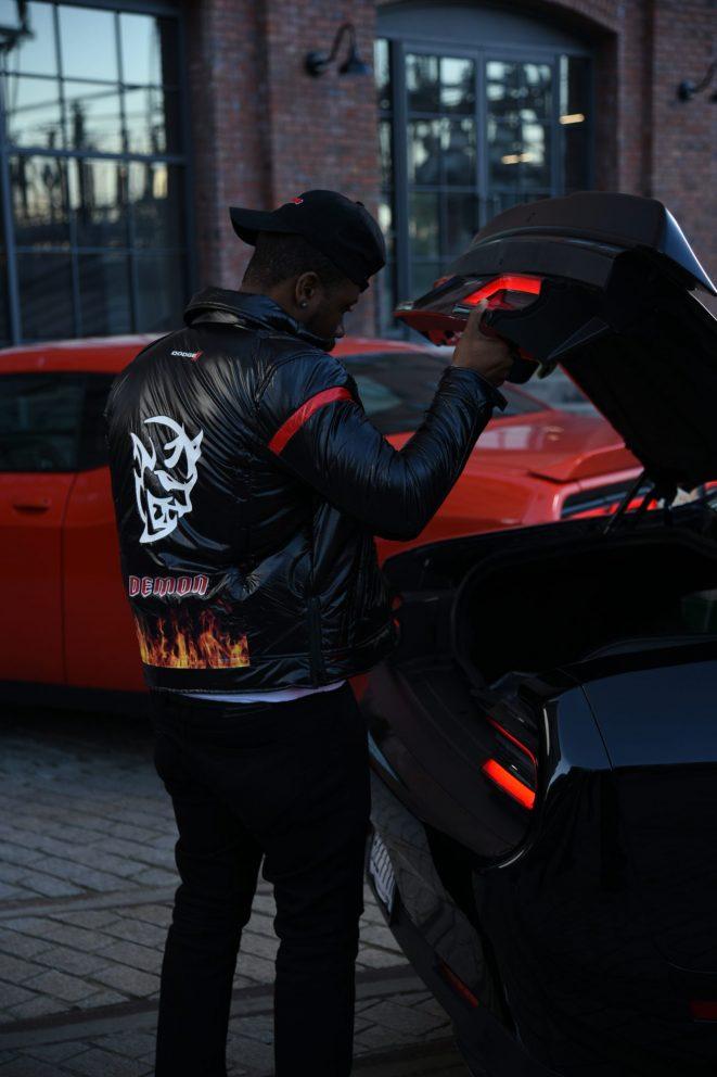 man wearing Demon jacket
