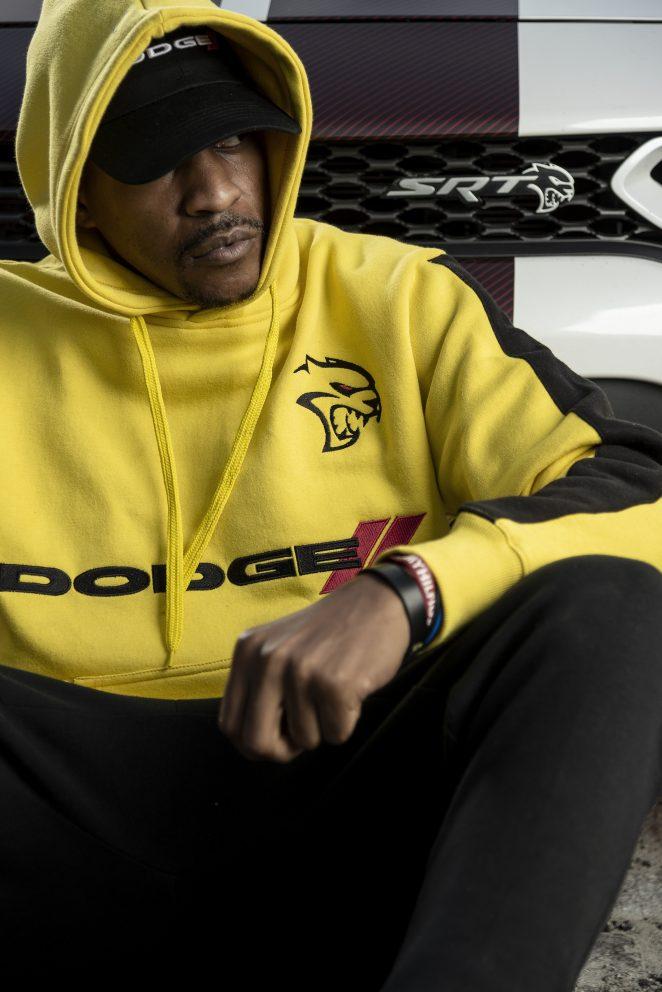 man sitting wearing a Dodge hoodie