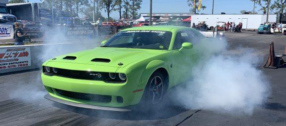 green challenger doing a burnout