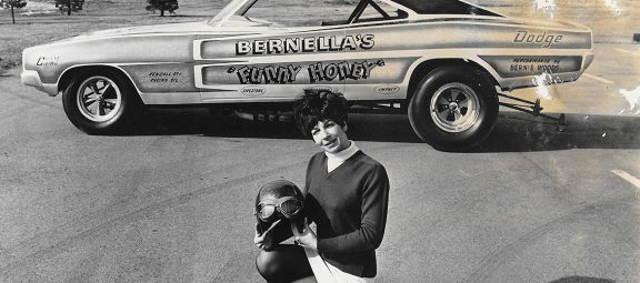 Della Woods posing with her funny car