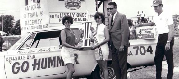 Mary Ann Foss receiving an award for drag racing
