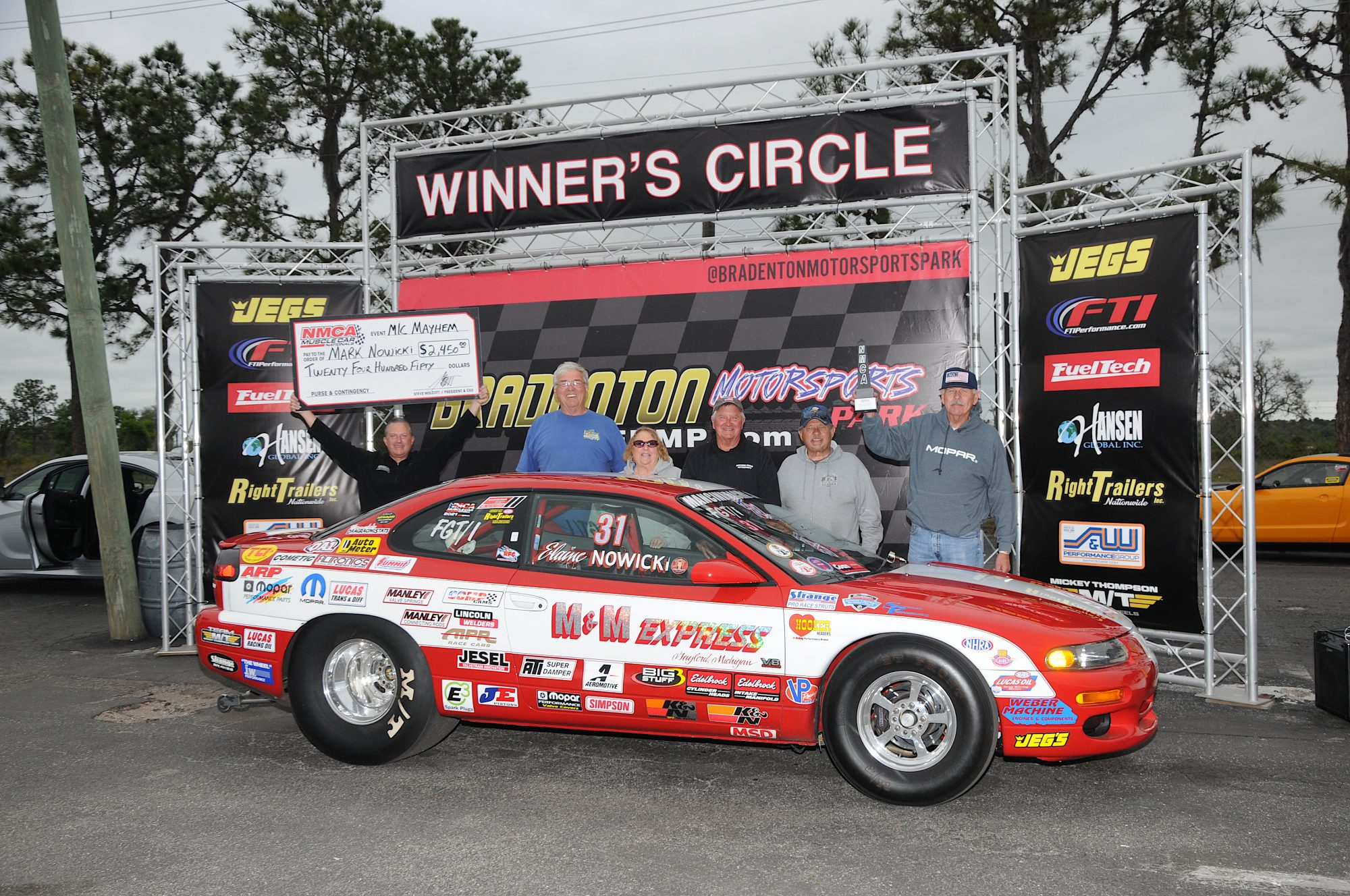 Mark Nowicki and his car in the winners circle