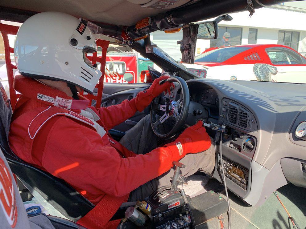 Mark Nowicki sitting in his race car