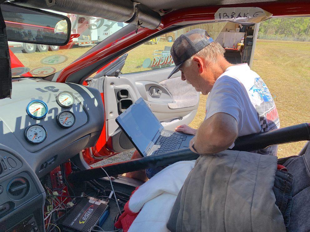 Mark Nowicki tuning his race car